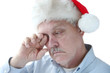 Santa hat on tired senior man