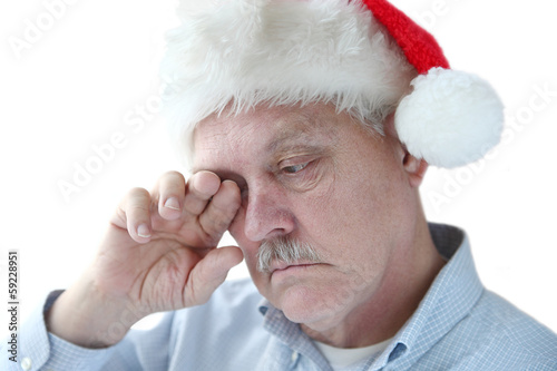 Santa hat on tired senior man