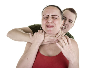 woman being strangled from behind by man on white background