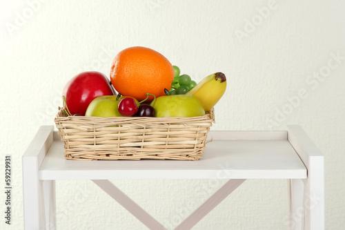 Fruit on white shelf on grey wall background