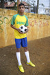 Young Brazilian Football Player Holds Soccer Ball