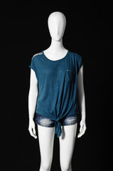mannequin female dressed in blue shirt and short