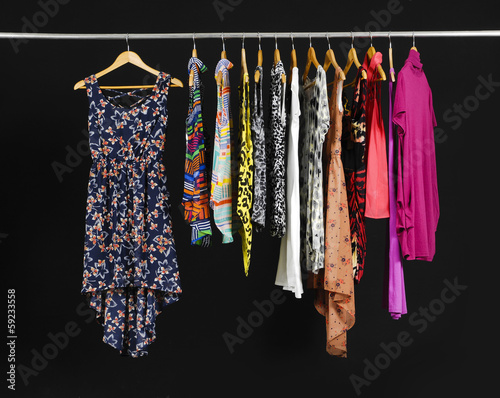 Female Variety of sundress clothes hanging on the rack