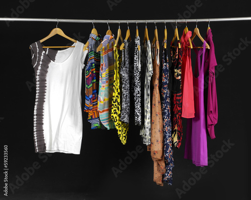 Female Variety of clothes hanging on the rack
