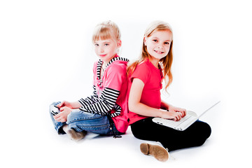 two small and beautiful girl with gadgets