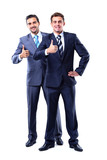 Two smiling businessman with thumb up