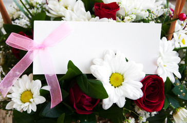 flowers with a white card