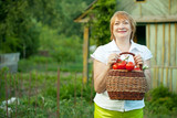 mature woman with basket of  vegetables