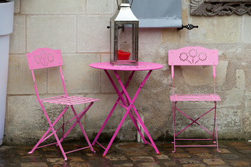 Empty pink table in the cafe during the rain