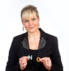 Studio portrait of a cute blond girl holding two letters forming