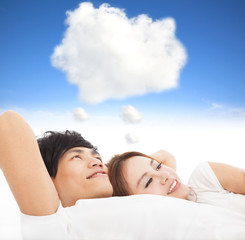 couple sleeping on the bed with dream cloud concept