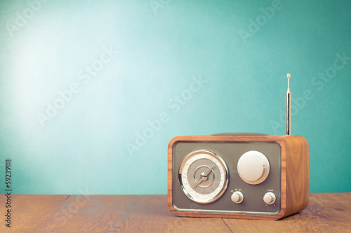 Leinwanddruck Bild Retro style radio receiver on table front mint green background