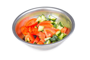 Fresh salad in metal bowl isolated on white