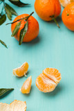 Skinless and fresh tangerines on a turquoise table