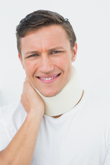 Close-up of a young man wearing cervical collar