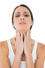Close-up of a casual woman suffering from neck ache