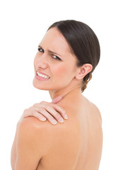 Close-up portrait of a topless woman with shoulder pain