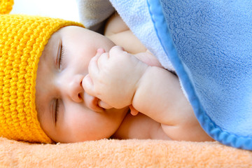 cute sleeping baby boy, beautiful infant face closeup