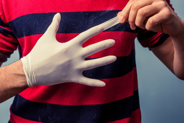 Man removing latex glove