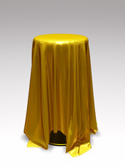standing table with tablecloth in gold