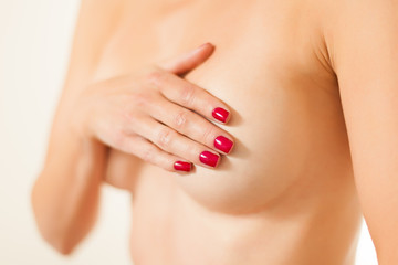 hand covering breast