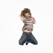 Jumping female street dancer with disheveled hair
