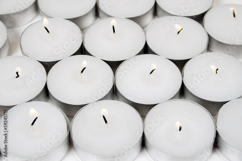 White background from burning candles