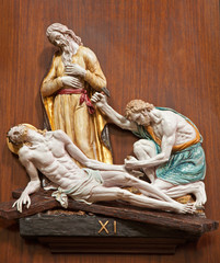 Verona -  Jesus is nailed to the cross - ceramic relief