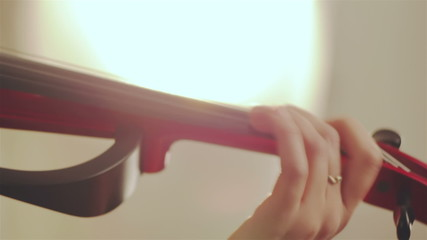Close up view of girl playing a violin showing detail