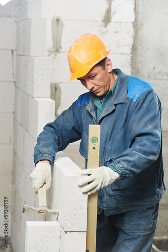 construction mason worker bricklayer with level