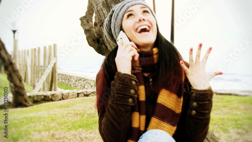 Woman madly happy on the phone