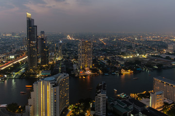 Bangkok city nightlife scene from 56th floor of hotel.
