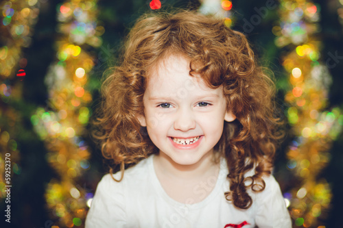 Beautiful little girl  looking at the camera and smiles on the