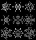 Set of drawn snowflake silhouettes