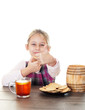 little girl showing thumb and eating cookies