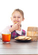 smiling girl eating cookie with honey
