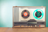 Retro reel to reel tape recorder front mint green background