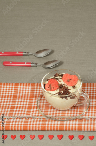 Valentine's Day tiramisu with chocolate in glass cup.