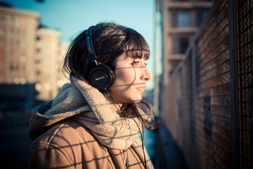 beautiful young woman listening to music headphones