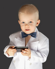 little boy with the mobile phone