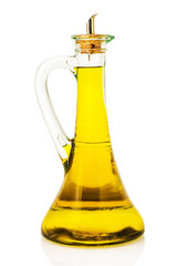 Olive oil in a glass bottle isolated over a white background