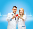 smiling doctors cardiologists with heart