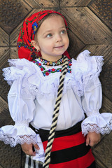 Young girl wearing romanian traditional clothes