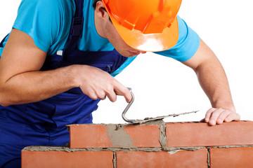 Handyman installing red brick