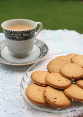 Tray full of biscuits served with tea