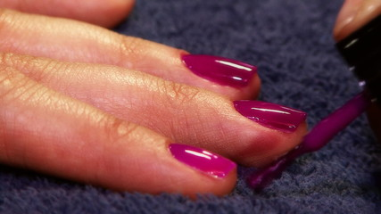 Closeup of fingernails being painted
