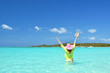 Girl with a seashell in the turqouise water of Atlantic. Exuma,