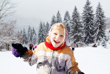 Little girl running in the snow