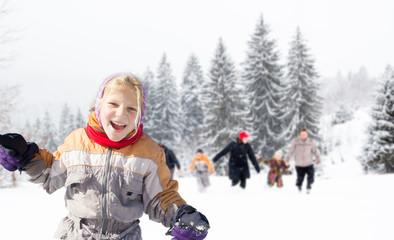 family having fun in the snow