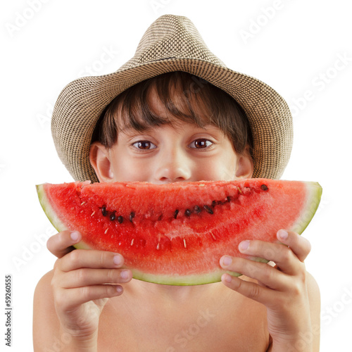 Little girl holding a piece of watermelon